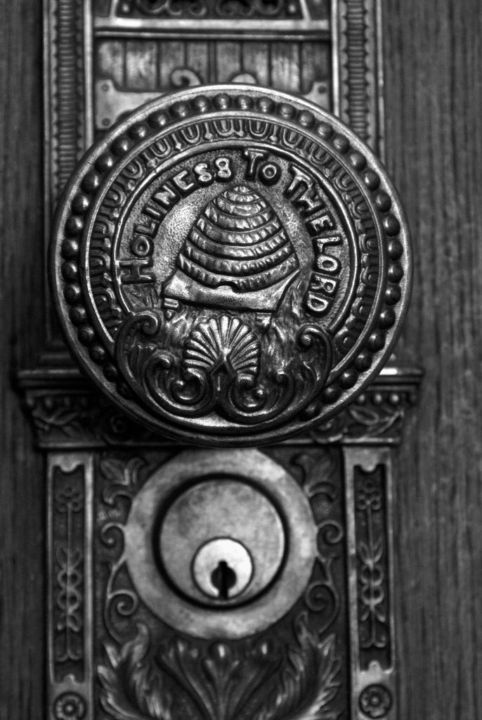 Salt Lake Temple doorknob. It says Holiness to the Lord over a beehive. The beehive has a seashell below it.
