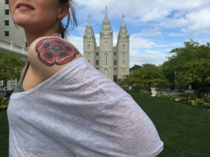 Selfie in front of the temple with t-shirt draped over my shoulder to reveal my rose tattoo.