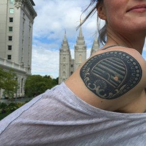 A selfie standing in front of the temple with my temple doorknob tattoo revealed.