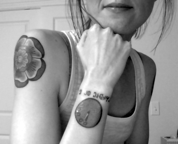 "Selfie leaning on my left hand to reveal a doomsday clock tattoo on my left wrist. It is bright red and says ""3 minutes to midnight"" underneath in Deseret Alphabet."